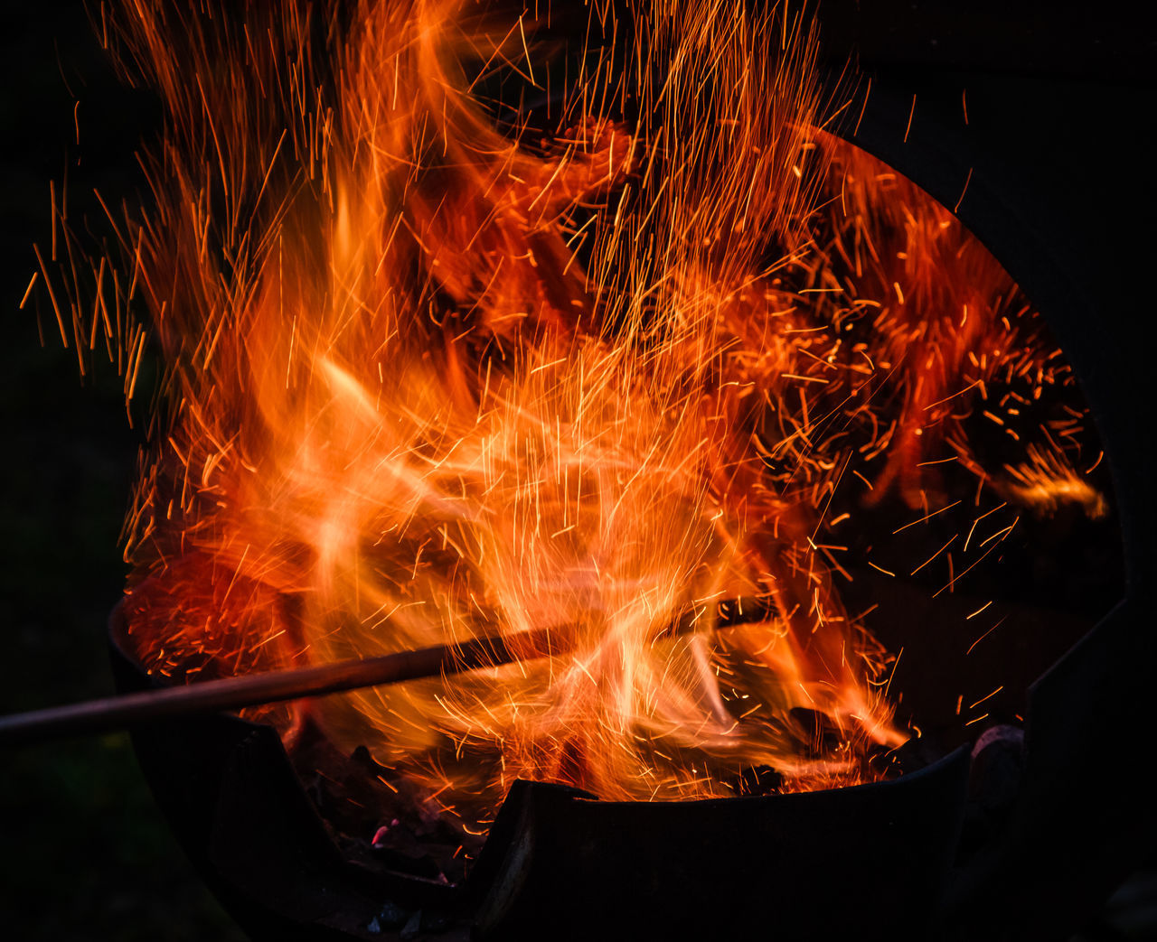 Black Backdrop Black Background Burning Close-up Fire Flame Heat - Temperature Night No People Outdoors Sparks Sparks Fly Sparks Flying