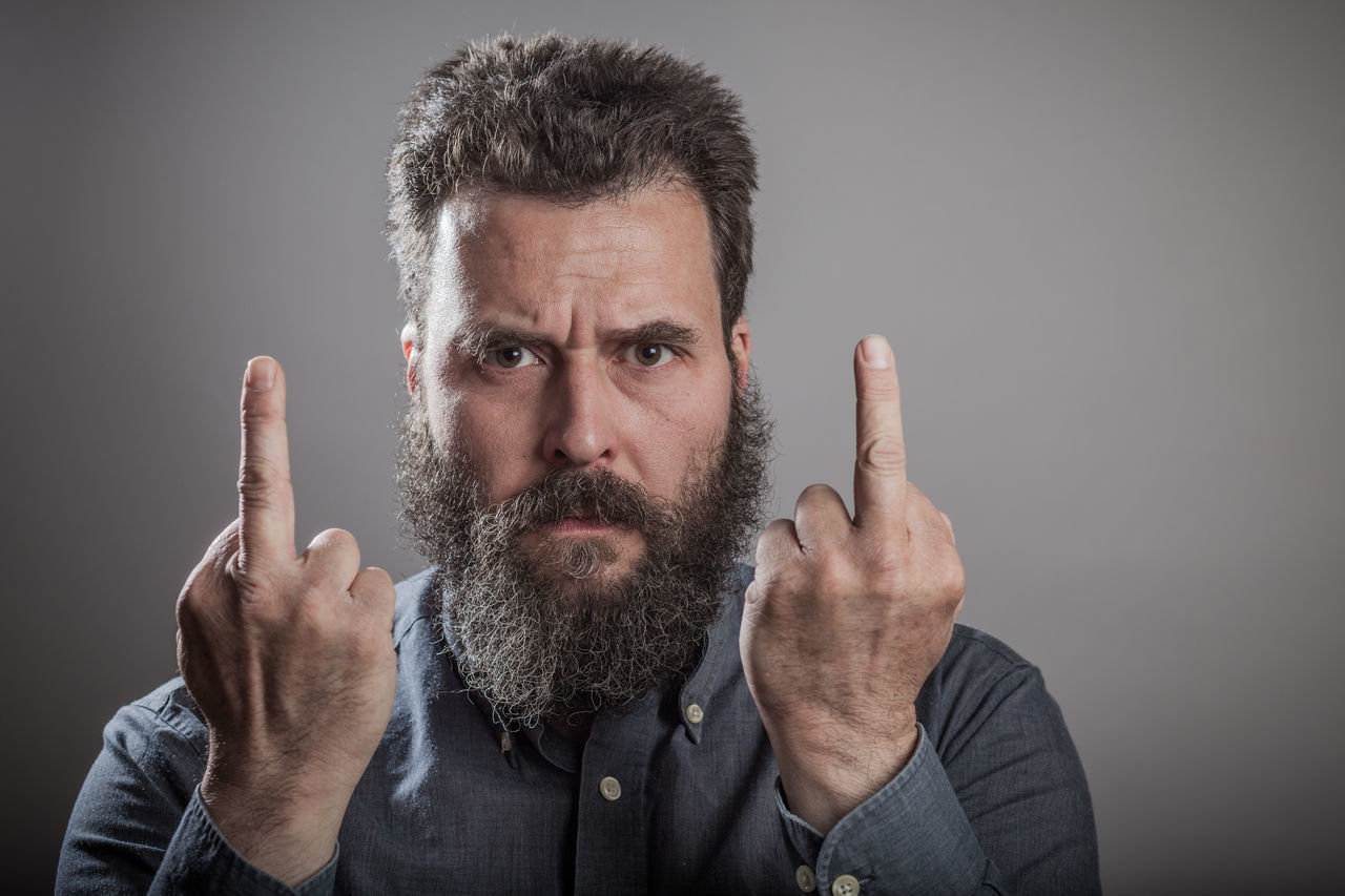 Mature man with long beard, head shots on grey background Anger Beard Disgust Emotions Front View Gesturing Gray Background Grey Background Headshot Lifestyles Looking At Camera Mature Adult Mature Men Mid Adult Mid Adult Men Middle Finger Mustache One Man Only One Mature Man Only One Person Only Men Portrait Real People Series Studio Shot