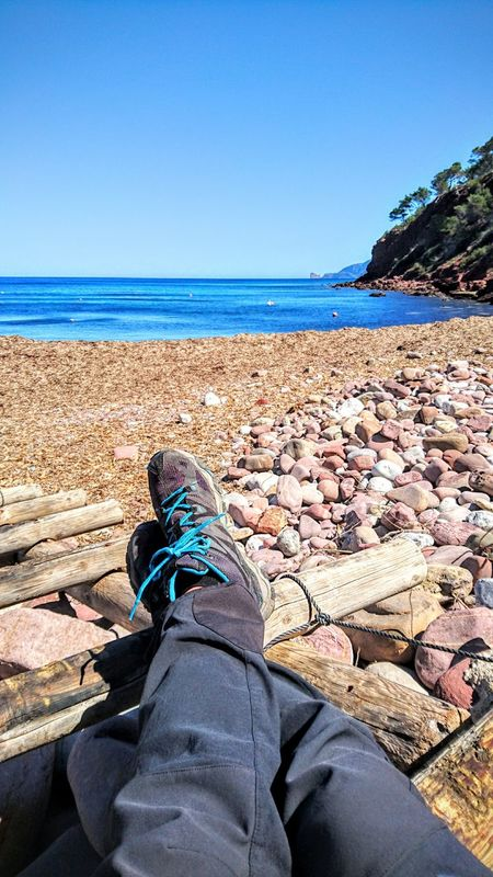 Total relax with seaview Relaxing Mediterranean Sea Mallorca Shoefie Boots View Waterfront Beach Horizon Over Water Serra De Tramuntana Text Space The KIOMI Collection Hiking Relax