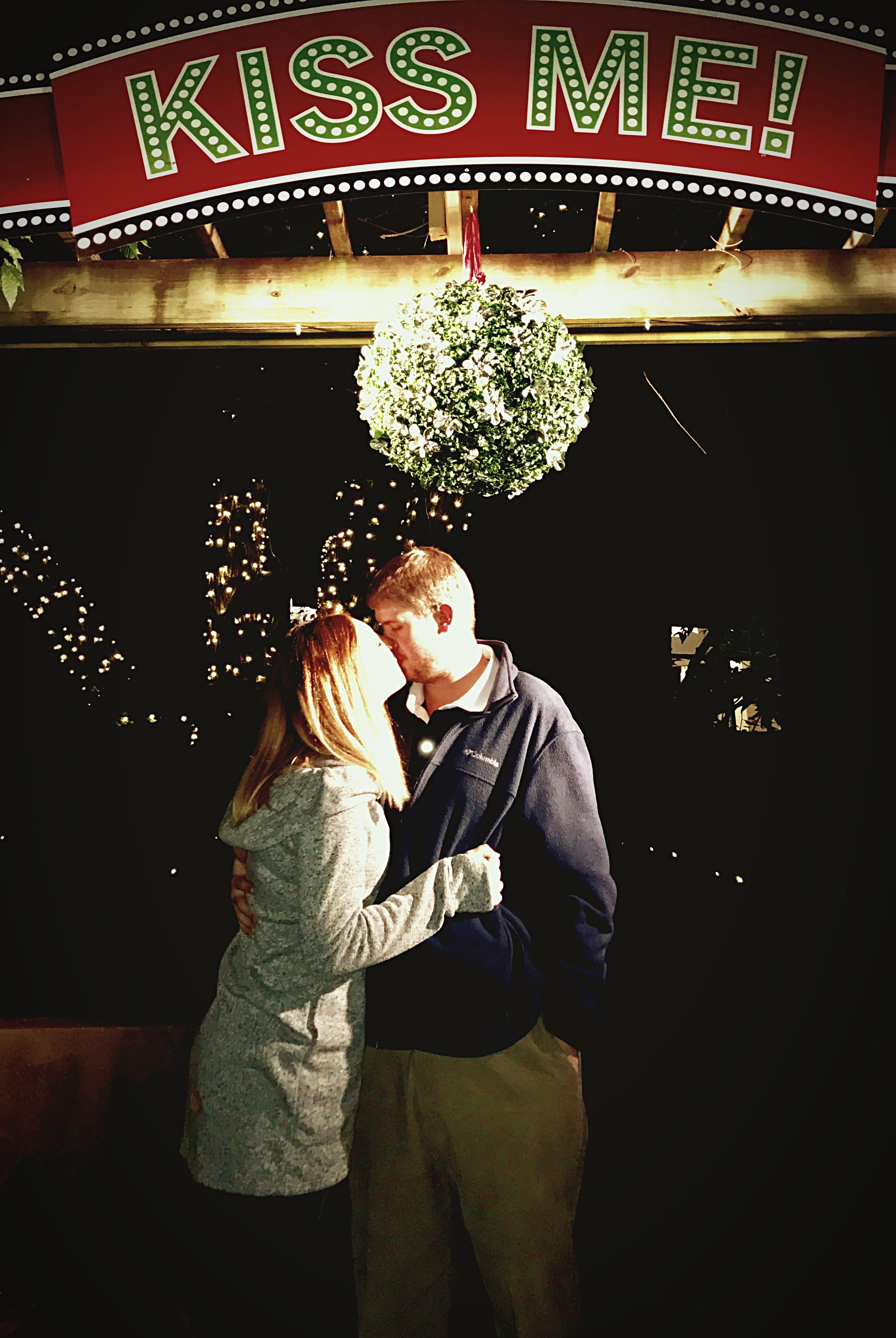 two people, heterosexual couple, togetherness, adults only, love, couple - relationship, happiness, smiling, adult, mature men, people, cheerful, christmas, men, mature adult, night, young women, christmas decoration, illuminated, women, young adult, indoors