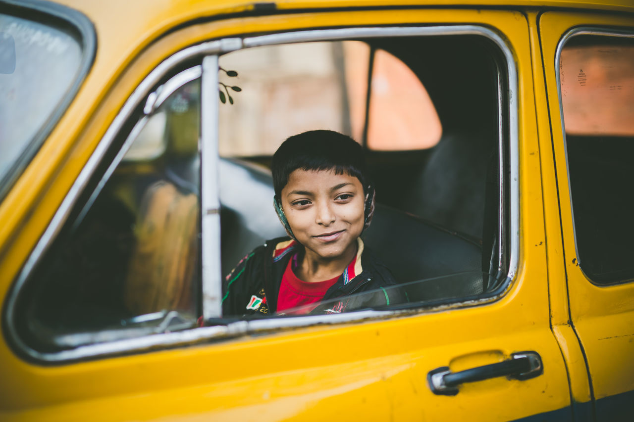 yellow smile Boy Car Cheerful City City Life Happiness Human Body Part Kid One Person Outdoors People Portrait Smiling Taxi Travel Window Yellow Taxi Young Adult