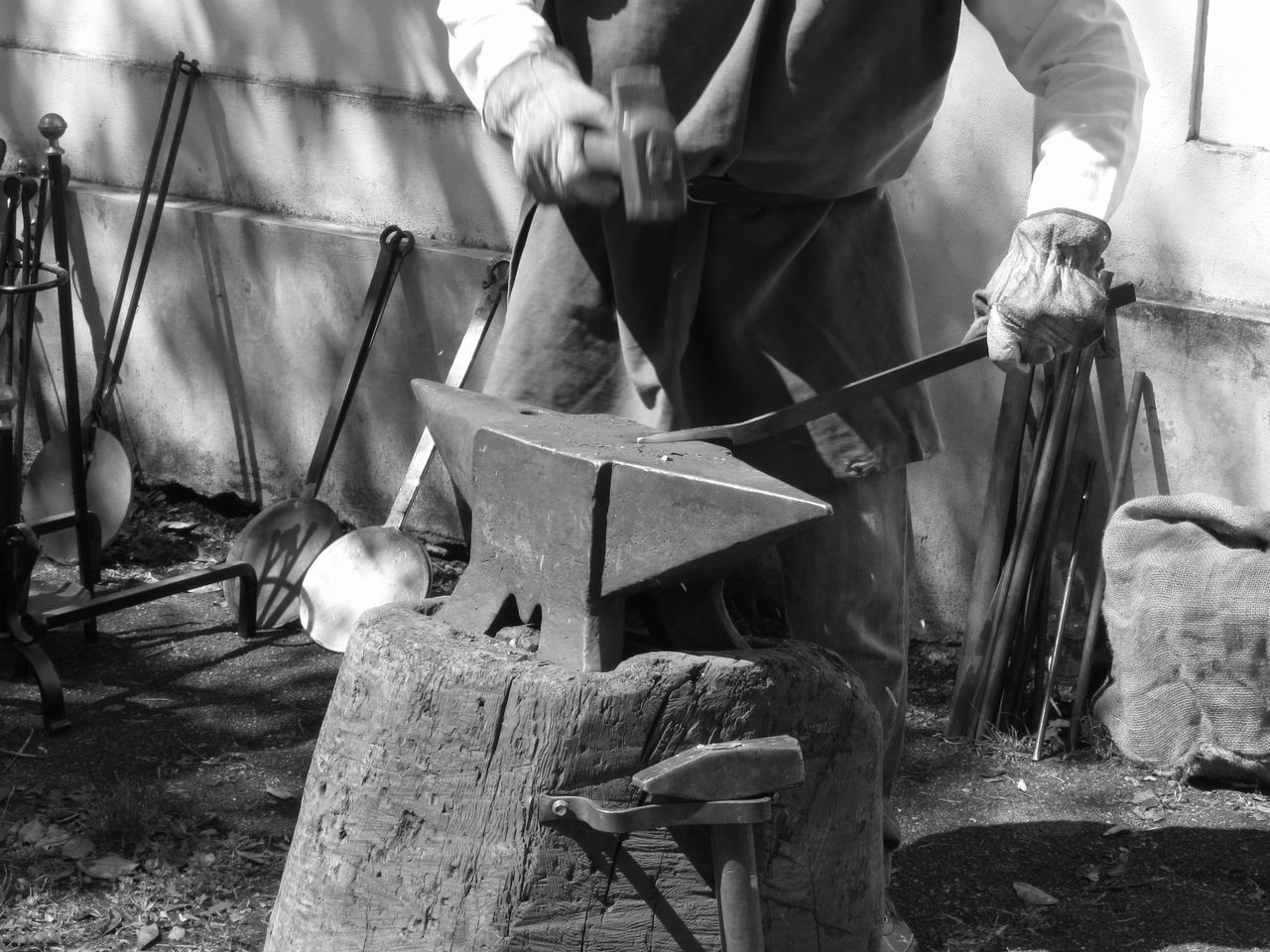 Blacksmith manually forging the molten metal with hammer on the anvil . Black and white photo . Photo taken during outdoor public event (no ticket required) in public place . Pistoia, Italy Anvil Black And White Blacksmith  Craft Craftsman Farrier Forge  Forging Glowing Hammer Hand Handmade Heavy Hot Incandescent Iron Ironwork  Manual Worker Metal Molten Rod Smith Spark Traditional Working