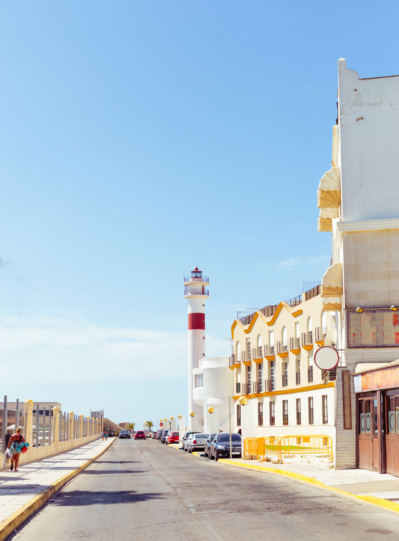 Tourism in spain. Vintage view of the lighthouse in Rota, Cadiz, Spain. Beach Cadiz Coast Coastline Europe Lighthouse Marina Mediterranean  Palm Palm Tree Promenade Scenics Sea Seaide Sunny Tourism Travel Vacation Vintage Water