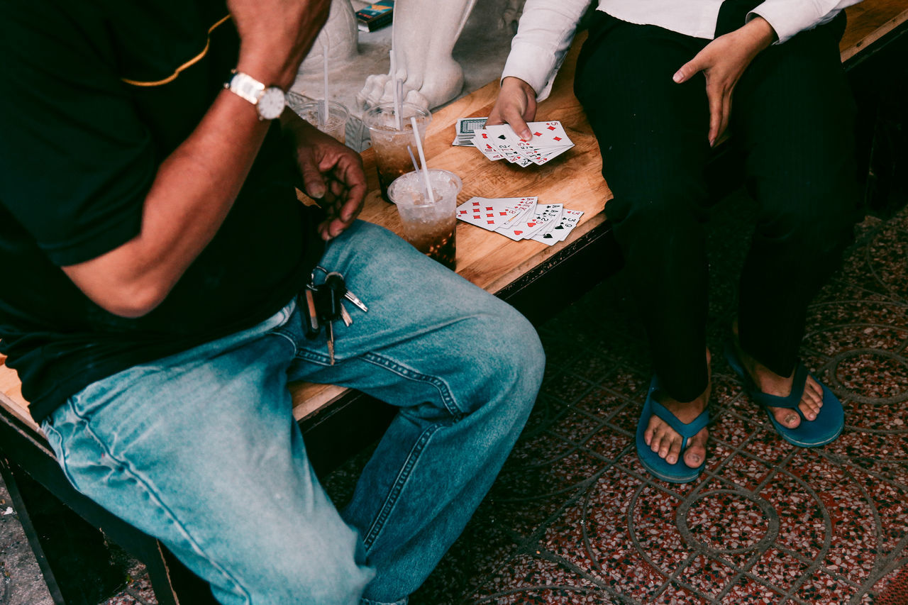 AMPt AMPt_community Candid Card Game Casual Clothing Crowd EyeEm EyeEm Best Shots Friendship Human Leisure Activity Low Section Men People People Of EyeEm People Watching Real People Sitting Street Streetphoto_bw Streetphotography The Street Photographer - 2017 EyeEm Awards Two People Vacation Time Vietnam