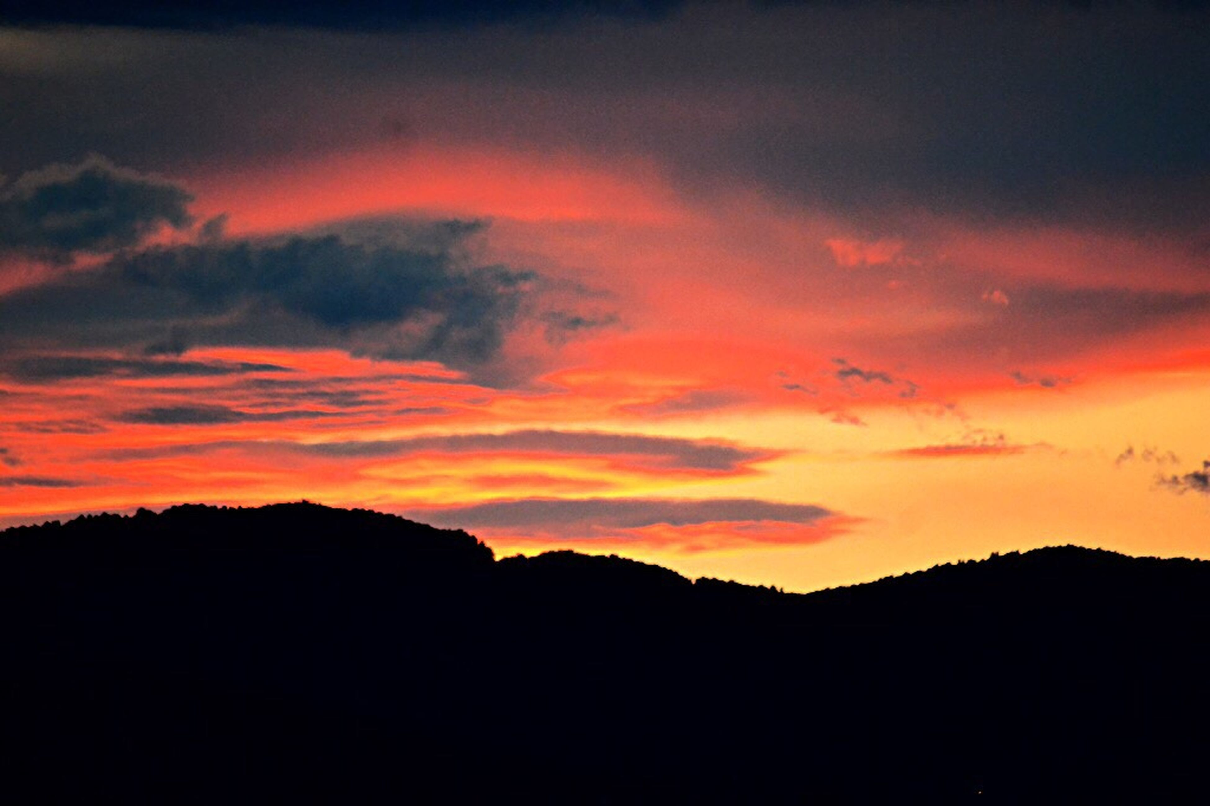 silhouette, sunset, beauty in nature, nature, scenics, dramatic sky, tranquil scene, sky, dark, no people, tranquility, outdoors, cloud - sky, backgrounds, tree, day