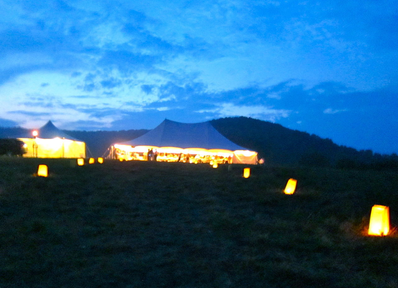 illuminated, night, outdoors, no people, sky, architecture, nature, mountain, building exterior