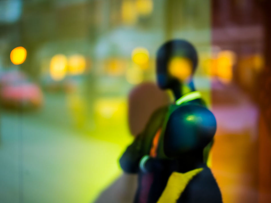 Watching the world go by! Adult Adults Only Business Close-up Focus On Foreground Mannequin Night One Person One Woman Only Outdoors People Real People Rear View Sport Starting Line Street Street Photography Streetphotography Yellow