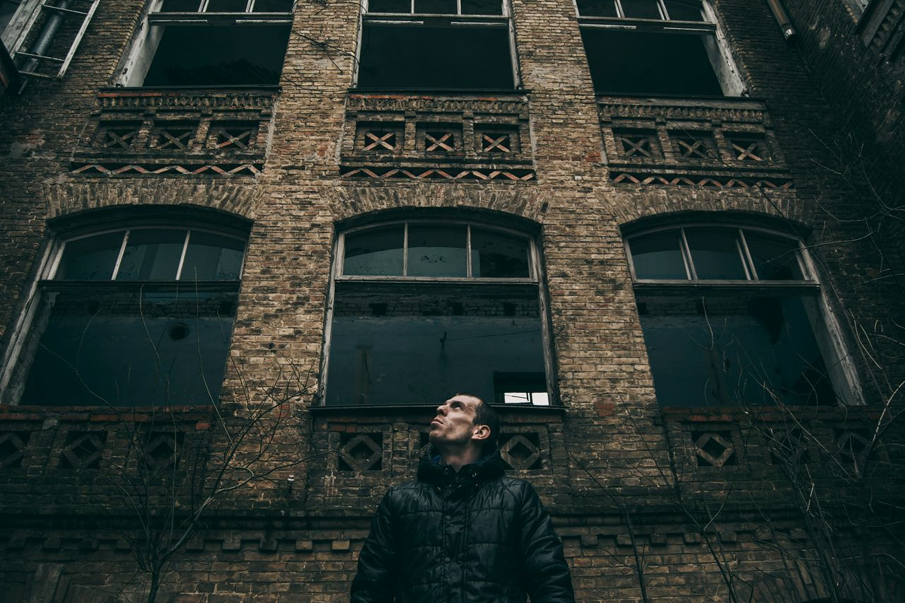 Low Angle View Architecture Building Exterior Outdoors Portrait Spooky Atmosphere Lifestyle Eyeem Photo Open Edit From My Point Of View By Ivan Maximov Abandoned Places Abandoned Buildings Indoors  Built Structure One Man Only Adults Only Wall Exceptional Photographs Looking Up Windows Only Men City Standing Abandoned Welcome To Black The Secret Spaces The Portraitist - 2017 EyeEm Awards The Architect - 2017 EyeEm Awards BYOPaper!