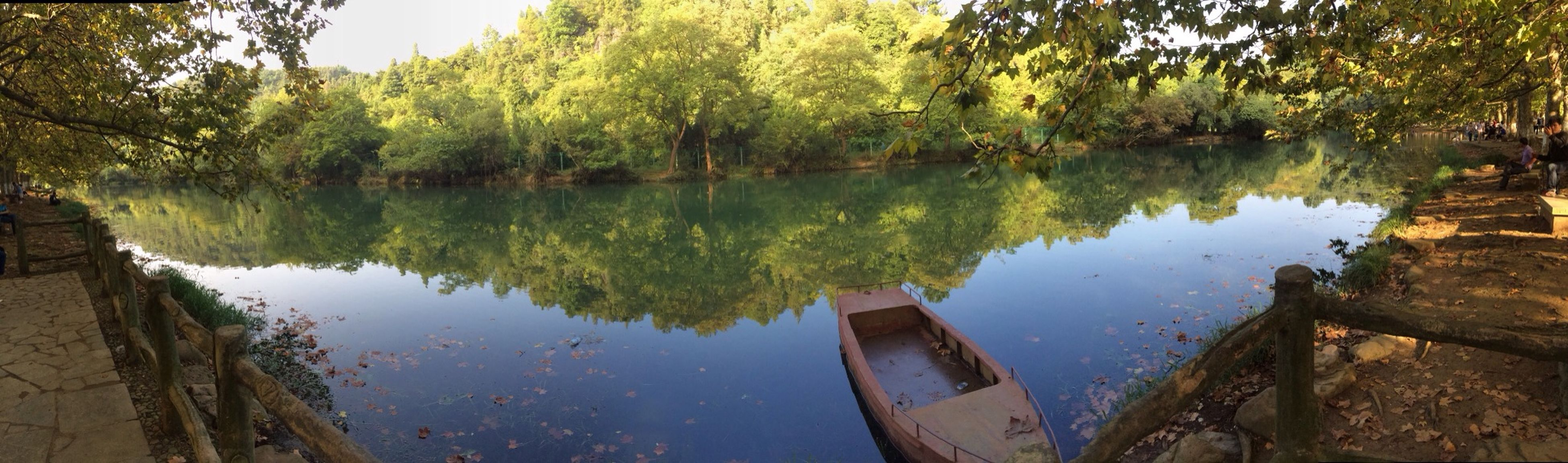 water, reflection, lake, tree, tranquility, tranquil scene, standing water, nature, beauty in nature, scenics, calm, day, sky, no people, blue, outdoors, growth, idyllic, river, green color