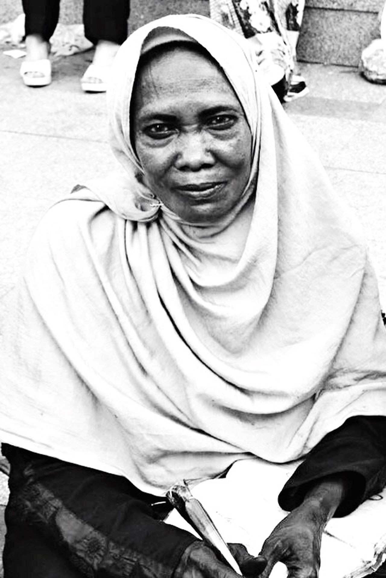 Untold Stories Cairo In Cairo EyeEmbestshots Blackandwhite EyeEm Best Shots - Black + White that poor woman who's making Henna ( Dye to adorn the skin ) for people on street for living every day , i gently asked her to take her a picture, she never mind , her simple smile that i'm sure many suffers and pains are hidden under gave me a hope to life , never gonna forget that i've met that simple woman one day ( her smile through my camera lens 😃 ) The Photojournalist - 2016 EyeEm Awards The Portraitist - 2016 EyeEm Awards
