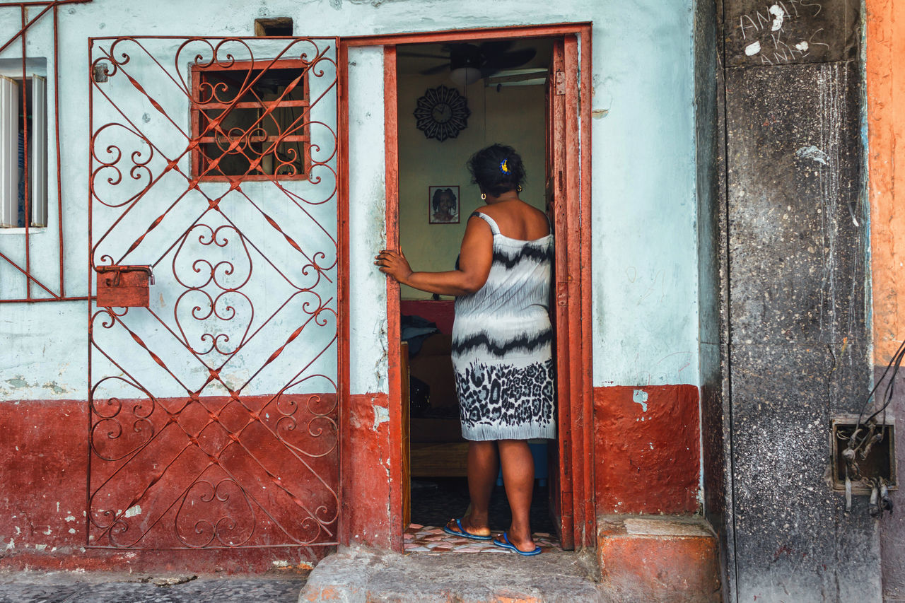 Adult Building Exterior Built Structure City Life Cuba Collection Cuban Life Door Doorway Full Length House Lifestyle Old Havana One Person Outdoors Poverty Real People Rear View Standing