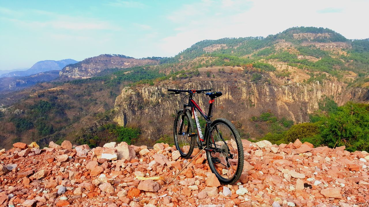 Bicycle Mountain Mode Of Transport Transportation Outdoors Day Mountain Bike Stationary No People Landscape Nature Sky Beauty In Nature Low Angle View