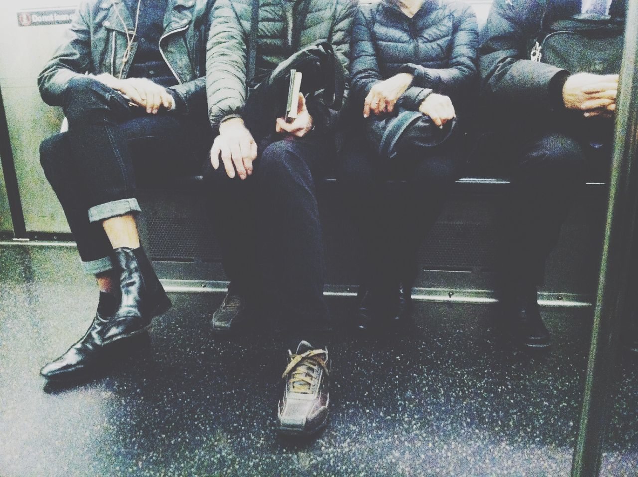 Low Section Of People Sitting In Train