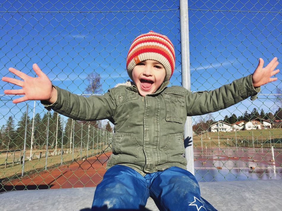 Boy Child Joy Joy Of Life Childhood Boys Human Body Part Front View Excitement Limb Cheerful Fun Son Human Mouth Outdoors Mouth Open Arms Raised Human Arm Warm Clothing Leisure Activity Sky People