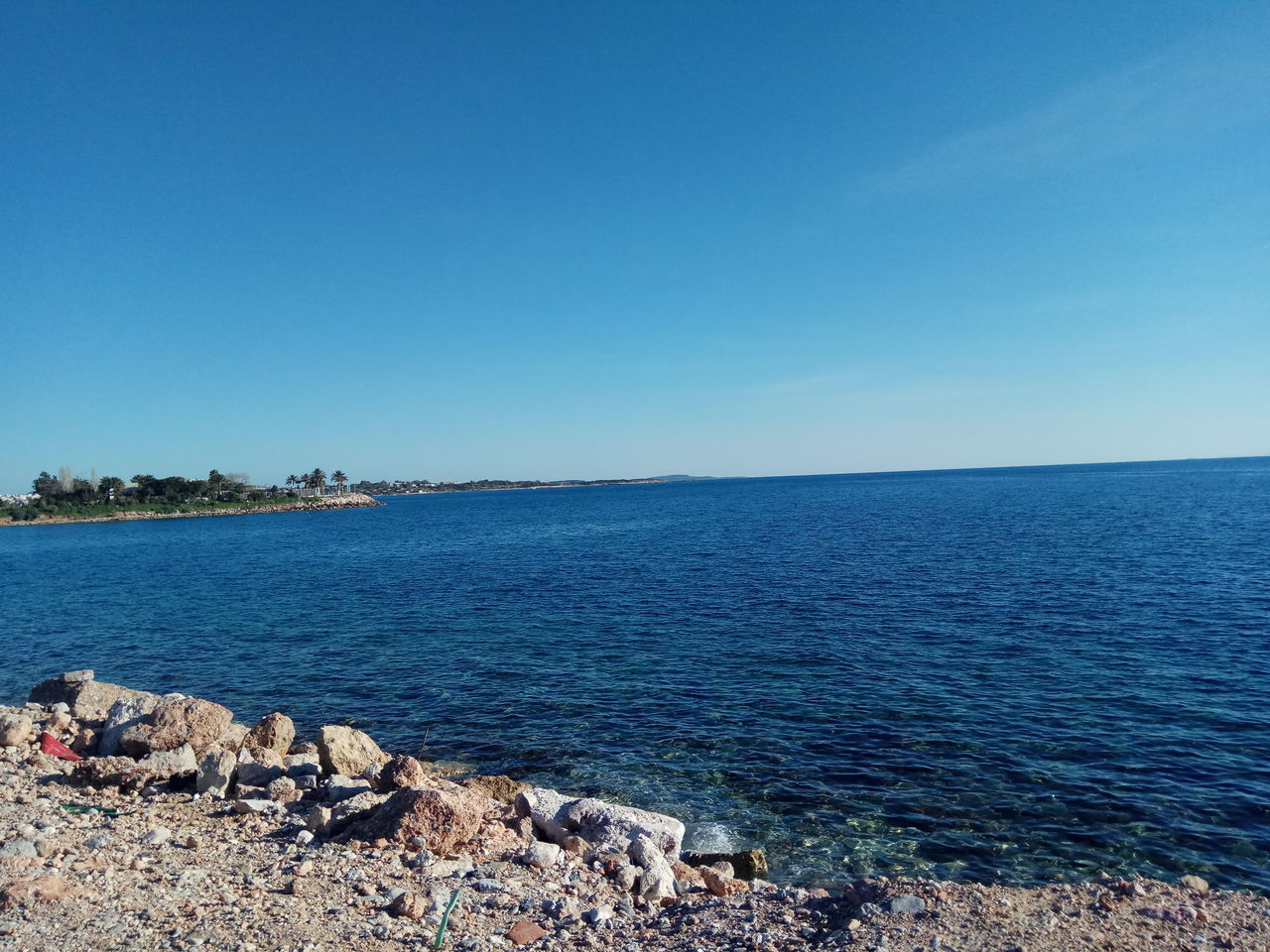 Blue Sea Sky Water Clear Sky Tranquility Outdoors Day Beach Beauty In Nature Nature Scenics Horizon Over Water Tranquil Scene No People Greece Photos Beauty In Nature Vacation Time Vacation Destination Travel Destinations Cloud - Sky