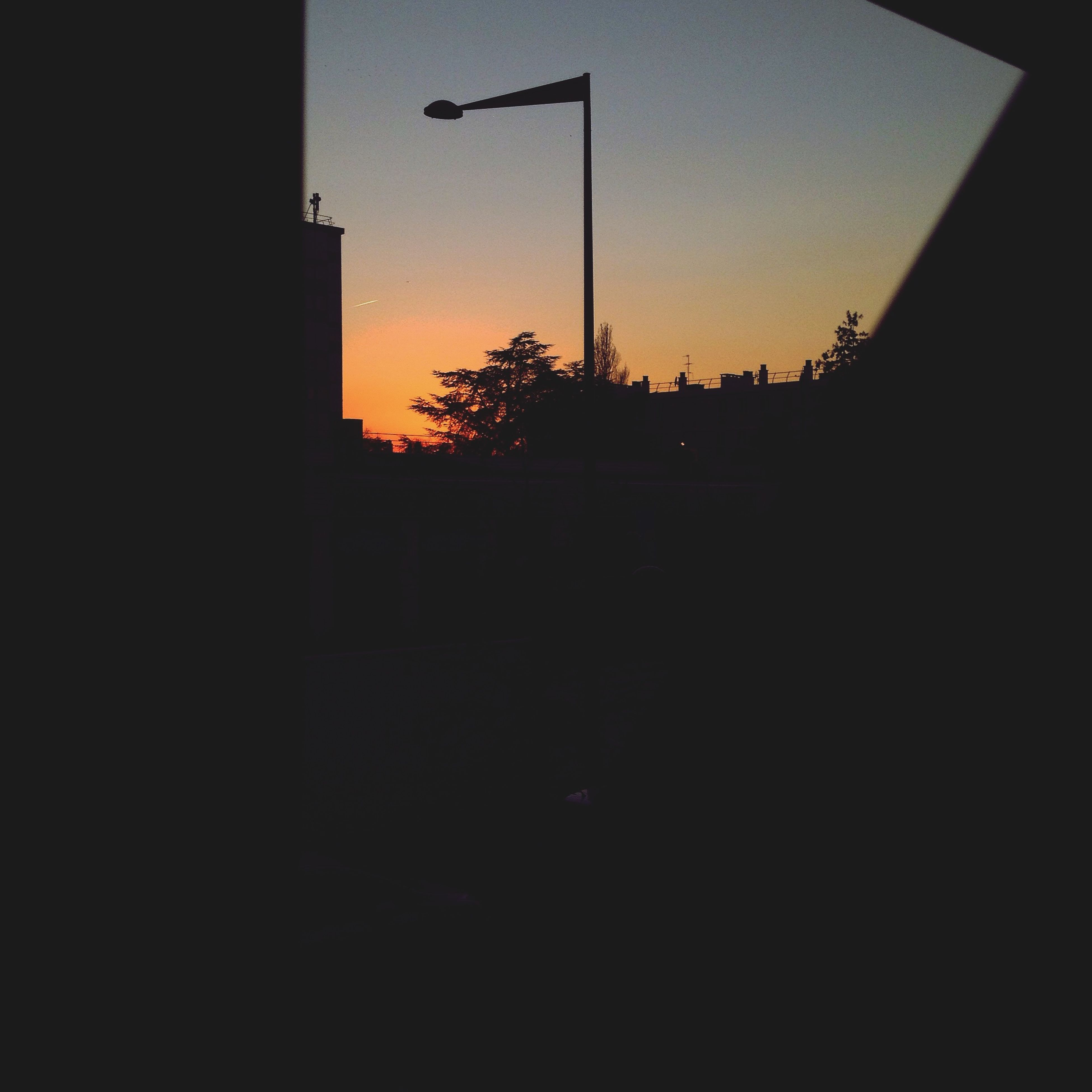 sunset, silhouette, built structure, architecture, building exterior, orange color, sky, dark, copy space, sun, clear sky, house, nature, no people, window, beauty in nature, sunlight, outdoors, scenics, dusk