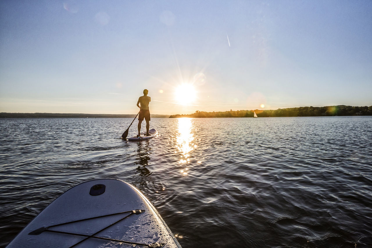 Standup paddler at the lake during sunset Adventure Ammersee Bayern Beauty In Nature Fitness Guide Lake Lifestyle Outdoors Paddling Scenic Silhouette Sports Standup Standup Paddleboarding Standuppaddle Sunlight Sunset Sup Surf Südtirol Tour Unfiltered Vacation Watersports