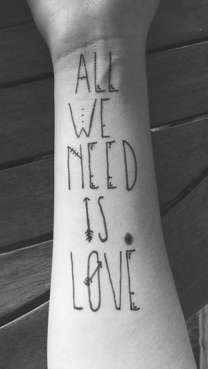 All we need is love, nothing else. Communication Close-up Text Handwriting  Person Human Body Part Horizontal One Person Indoors  Adult Only Women Day People Love Tattoo Design Tattooed Blackandwhite Photography Violet Design Tattoo Design Phrases Quotes Love All We Need Is Love Tattooartist