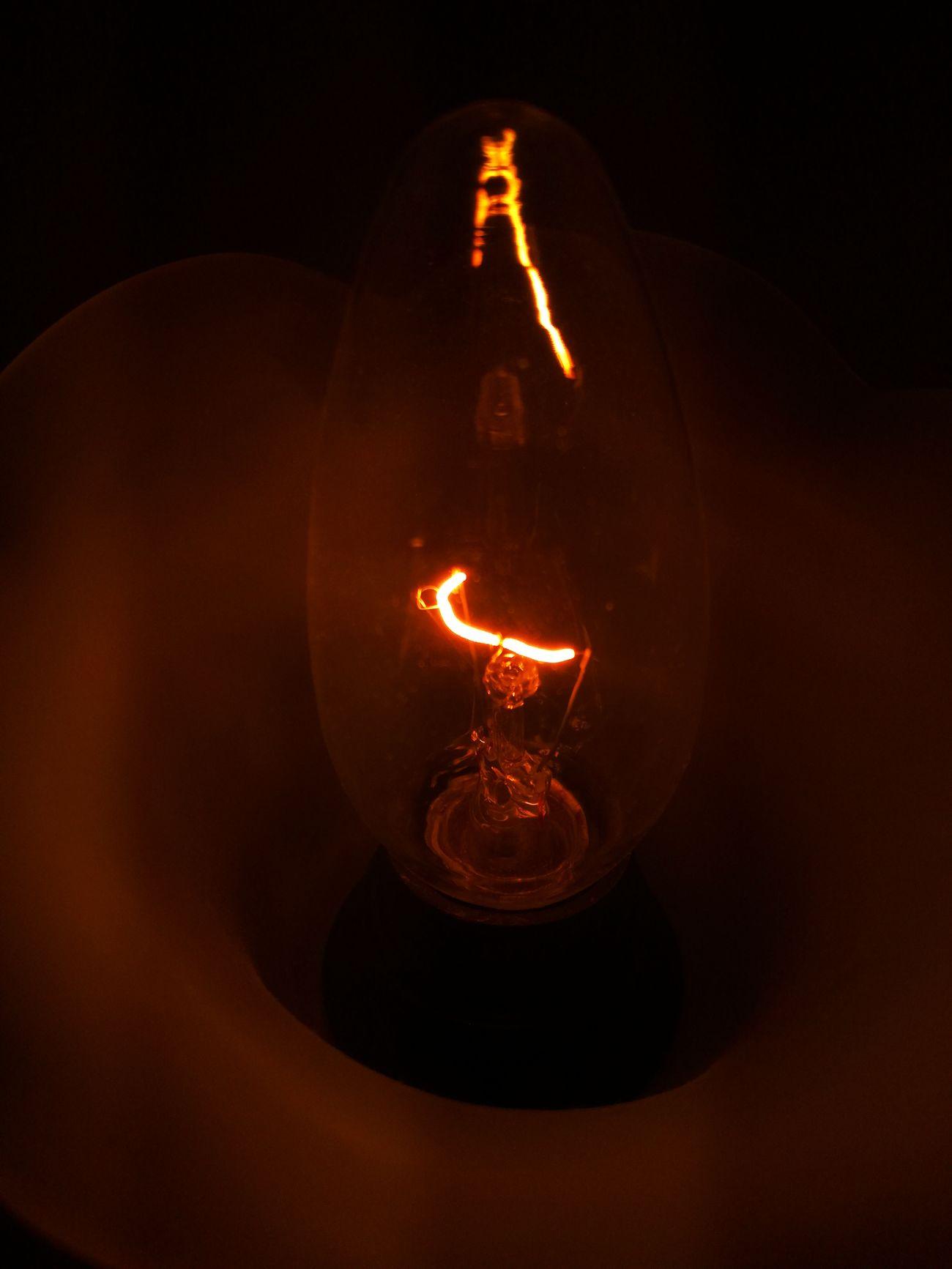 Electricity  Heat - Temperature Illuminated Light Bulb Filament Night Black Background No People Close-up Flame Lighting Equipment