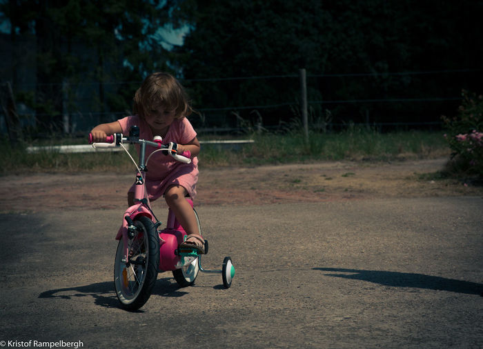 Child Childhood Children Only Enjoyment Fun Girl Leisure Activity Lifestyles One Person Outdoors People Playing Real People Riding