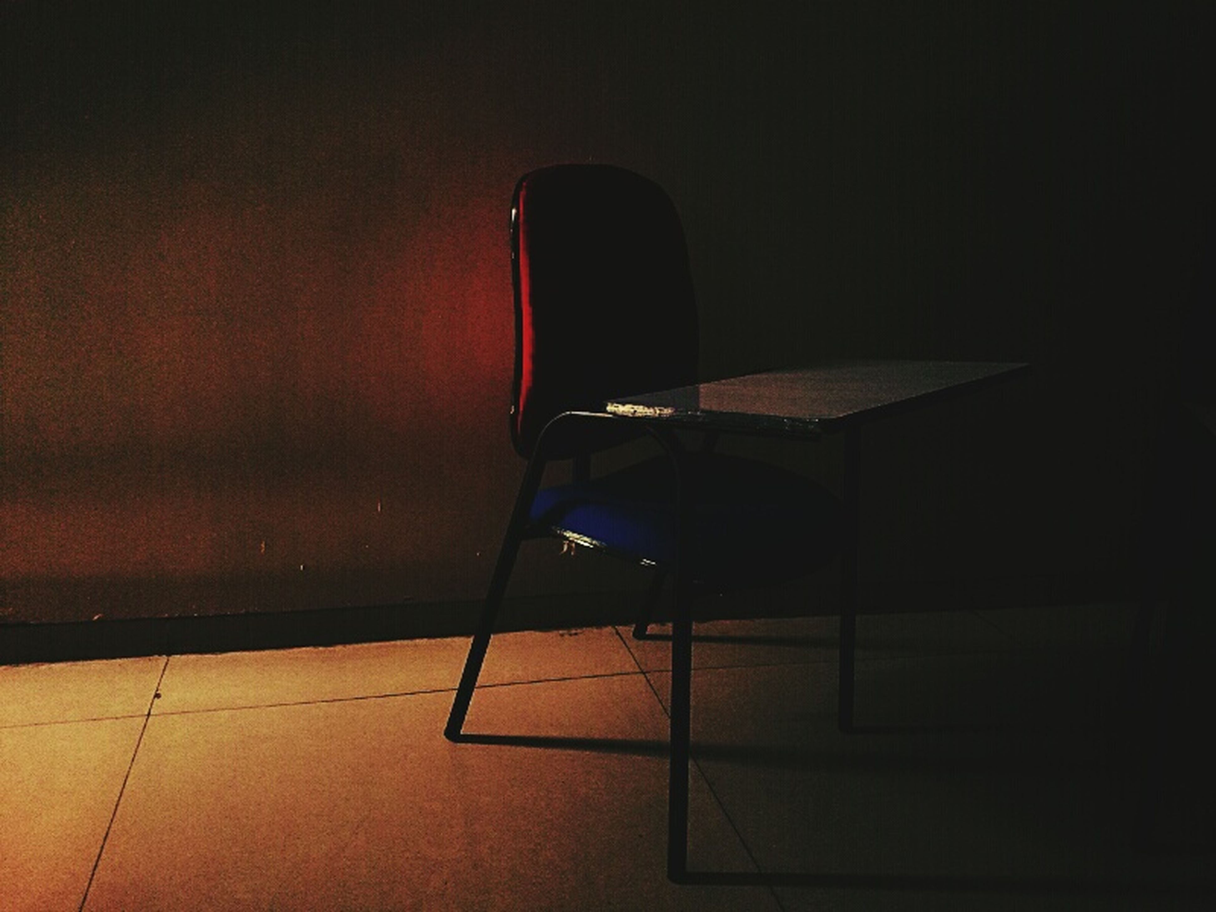 indoors, empty, absence, illuminated, chair, built structure, no people, architecture, wall - building feature, shadow, sunlight, lighting equipment, table, seat, flooring, high angle view, home interior, wall, dark, night