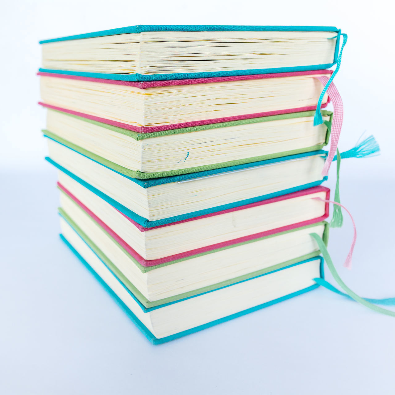 Colorful Books Blue Books Colorful Colors Cyan Day Education Educational Green Learning LearningEveryday No People Paper Pink Reading Reading Books Reading Time Stack Studio Shot Study Hard Study Time Studying Symbol White Background