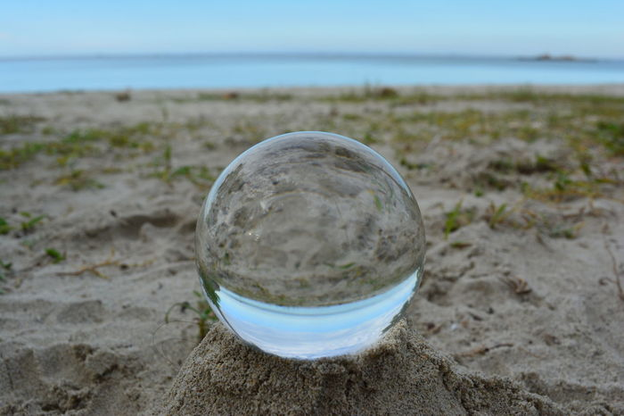 Beach Beauty In Nature Circle Close-up Crystal Ball Day Focus On Foreground Grass Horizon Over Water Landscape Nature No People Outdoors Reflection Sand Scenics Sea Sky Sphere Tranquility Water Let's Go. Together.