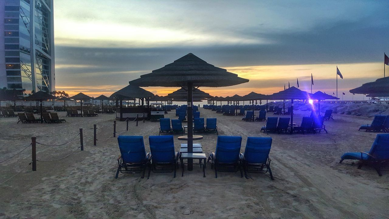 Lounge Chairs Outside Jumeirah Beach Hotel During Sunset
