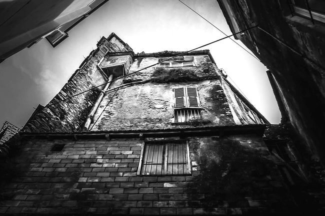 Architecture City Built Structure Metal Building Exterior Outdoors Low Angle View Climbing Sky Day No People Fire Escape Blackandwhitephotography Streetphotography Streetphoto_bw