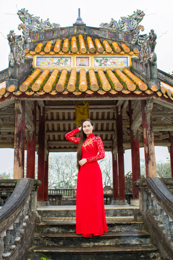 Traditional Clothing Cultures Red Religion Adult Only Women Adults Only Travel Destinations One Person One Woman Only People History Tradition Standing Portrait Architecture Royalty Beautiful Woman Young Adult Day