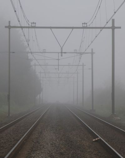 Fog Railroad Track Cable Power Line  Electricity Pylon No People Trough The Lens Canonphotography Eos70d EyeEmNewHere No Edit/no Filter Just Me And My Camera Pure Photography No Filter, No Edit, Just Photography Canon_photos Foggy Morning Canon 70d Canon EOS 70D Breathing Space Investing In Quality Of Life The Week On EyeEm EyeEm Selects Foggy Morning Fog Early Morning