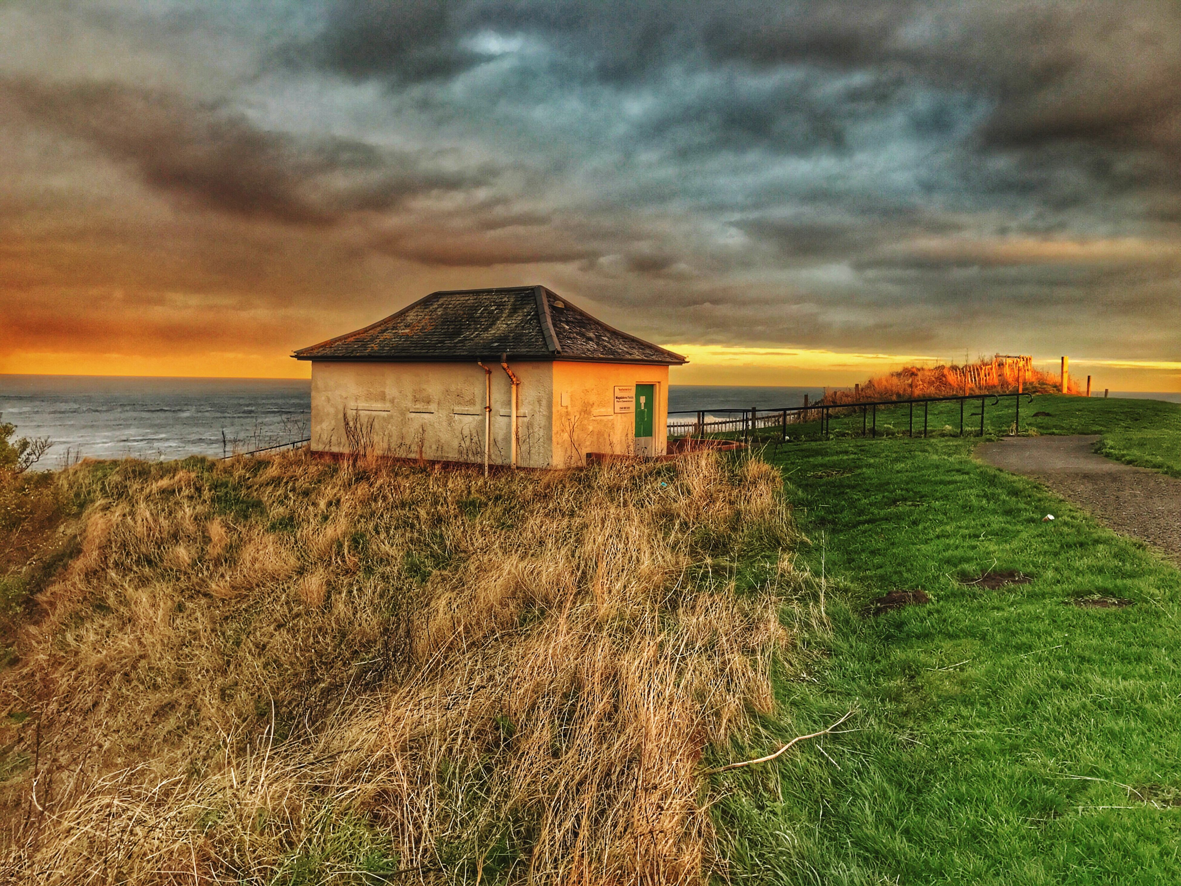 sky, sea, cloud - sky, horizon over water, nature, water, beauty in nature, outdoors, architecture, built structure, beach, no people, tranquility, scenics, building exterior, day