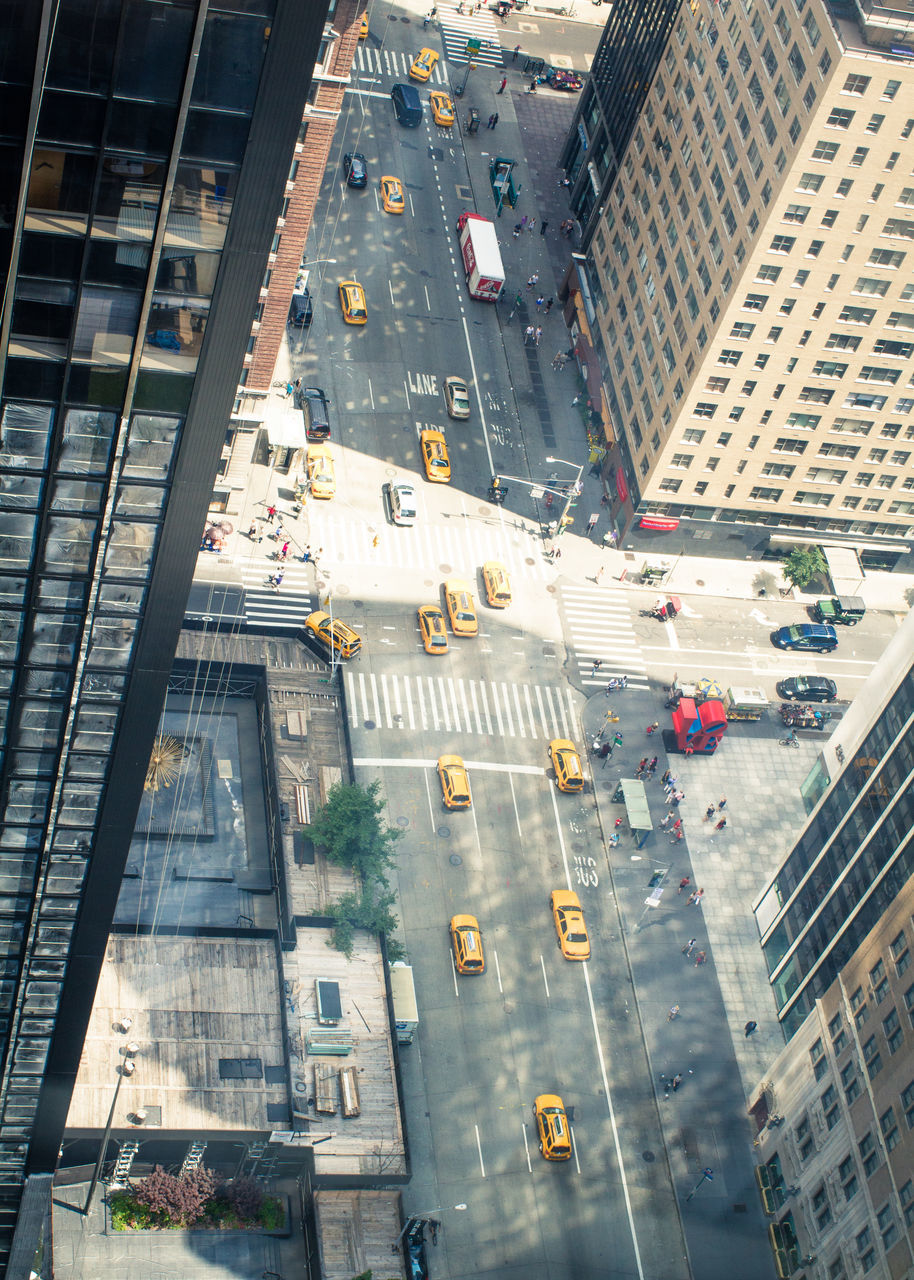 architecture, city, high angle view, building exterior, transportation, built structure, street, road, city life, outdoors, day, land vehicle, skyscraper, cityscape, no people