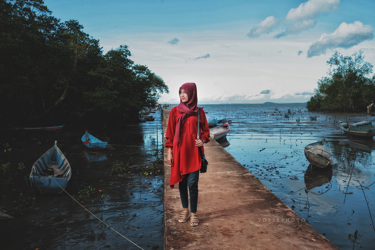 real people, full length, standing, water, one person, reflection, front view, lifestyles, outdoors, nature, day, young adult, lake, young women, portrait, sky, tree, beautiful woman, people