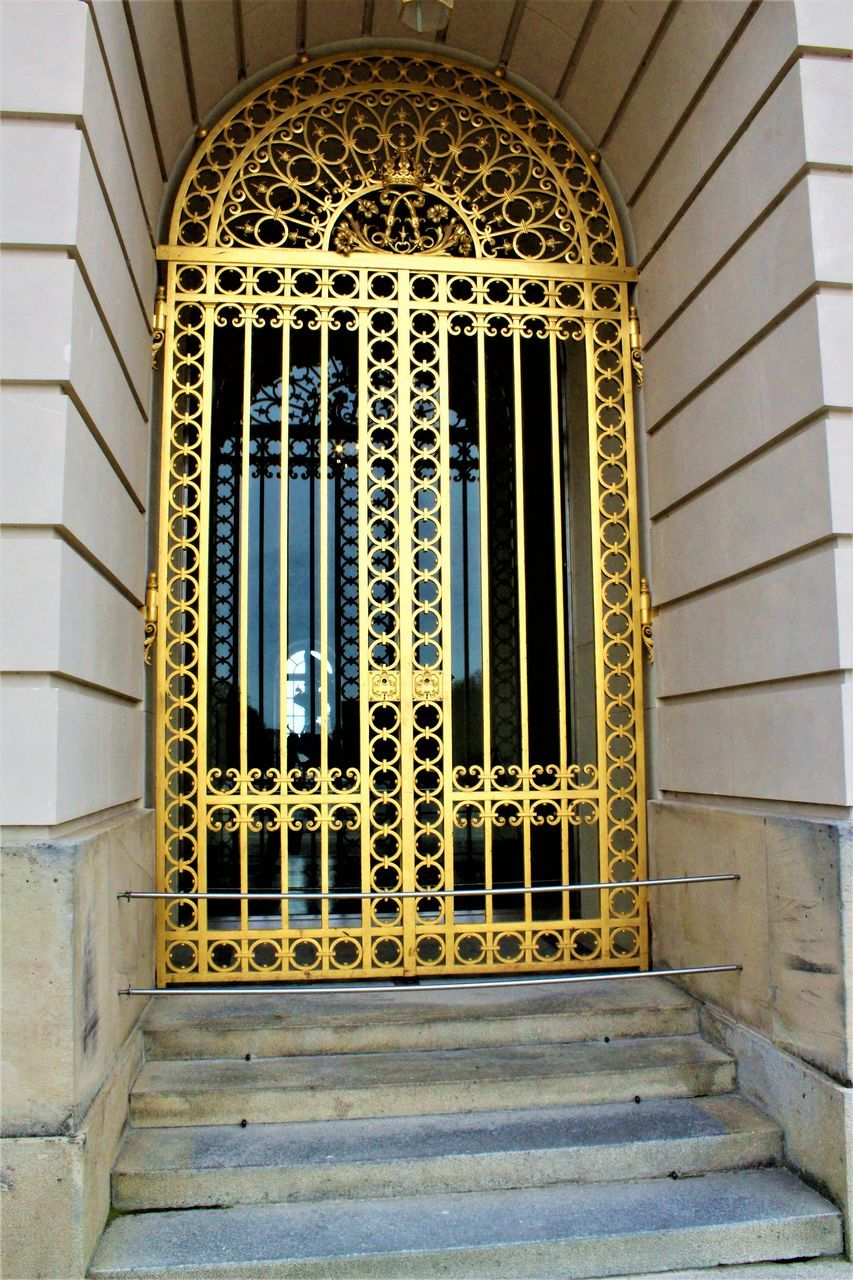 architecture, built structure, no people, window, pattern, yellow, day, building exterior, metal grate, outdoors, close-up