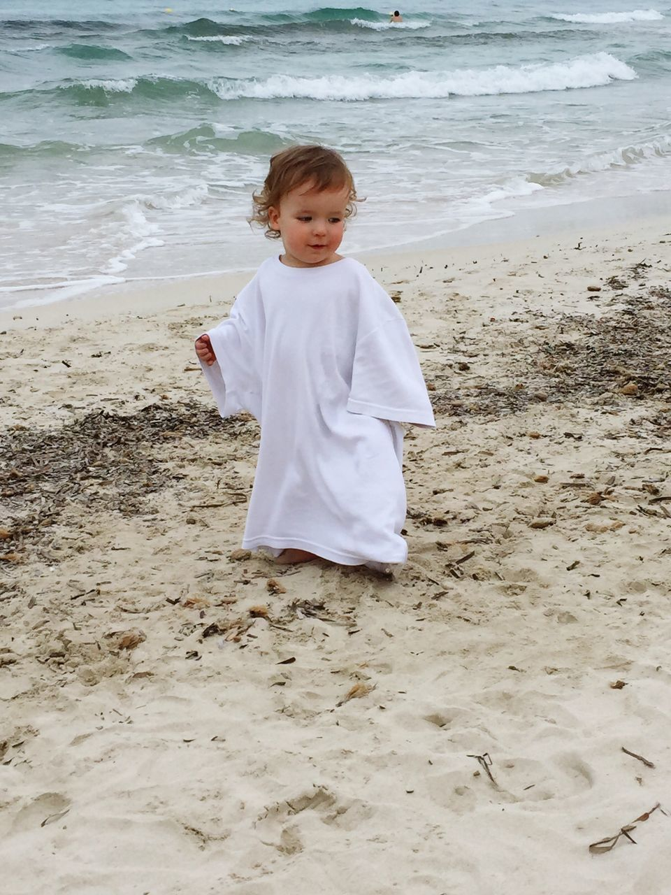beach, sand, childhood, sea, boys, shore, one person, real people, water, wave, leisure activity, full length, standing, nature, day, lifestyles, outdoors, vacations, one boy only, sand pail and shovel, people