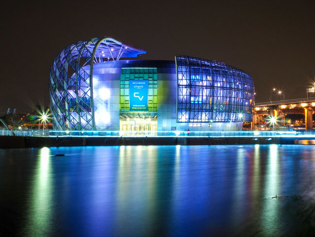 Architecture Building Exterior Built Structure City City Life Electric Light Famous Place Han River Park Illuminated Modern Night No People Office Building Outdoors Reflection Seoul Skyscraper Surface Level Tourism Travel Destinations Water Waterfront