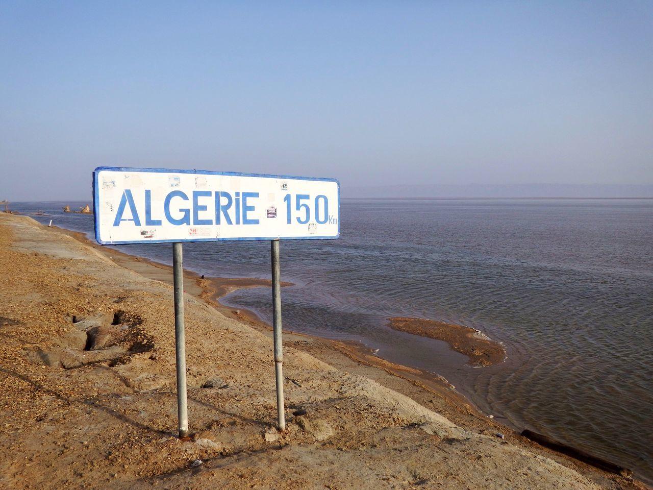 Lake Lakeshore Desert Streetsign Chott El Djerid Tunesia No People Traveling Day Sunshine Sign Blue Sky Wather