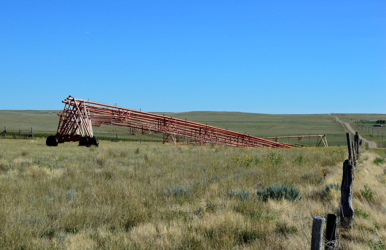 Along a country road Along A Country Road Clear Sky Equipment Taken Apart Irrigation Equipment No No People Out In The Boondocks Prairie Center Wyoming Rural Scene