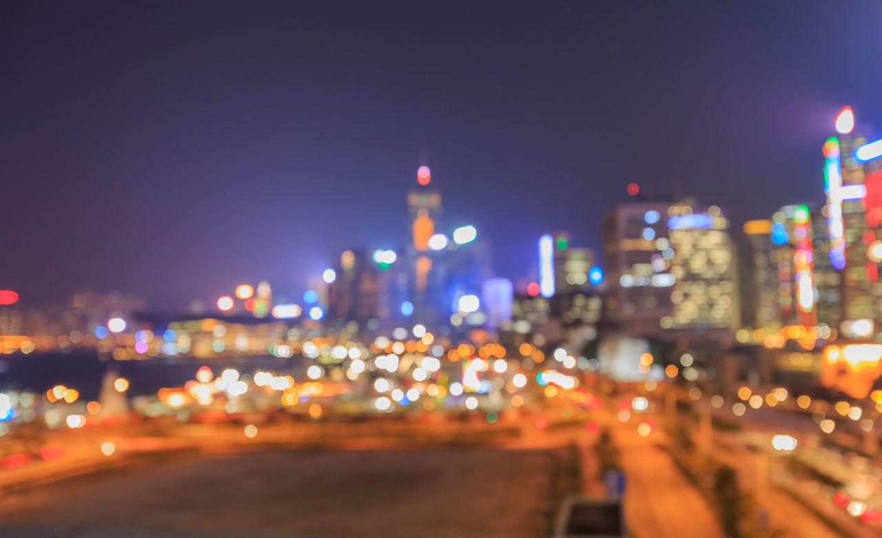illuminated, night, city, architecture, built structure, building exterior, cityscape, city life, outdoors, defocused, sky, urban skyline, skyscraper, no people