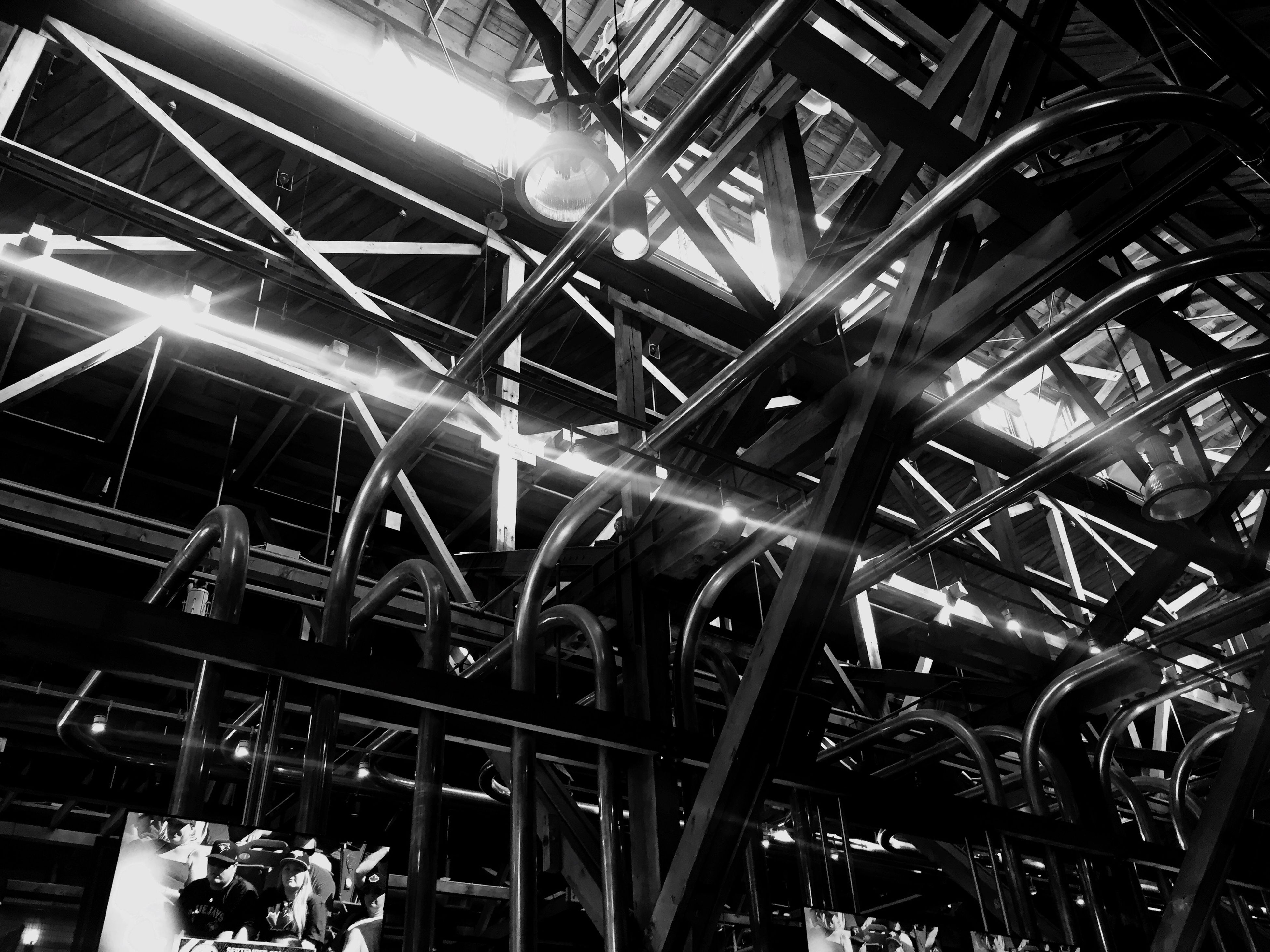 low angle view, metal, built structure, architecture, metallic, ceiling, indoors, abandoned, grid, architectural feature, pattern, industry, backgrounds, full frame, no people, old, damaged, geometric shape, complexity, iron - metal