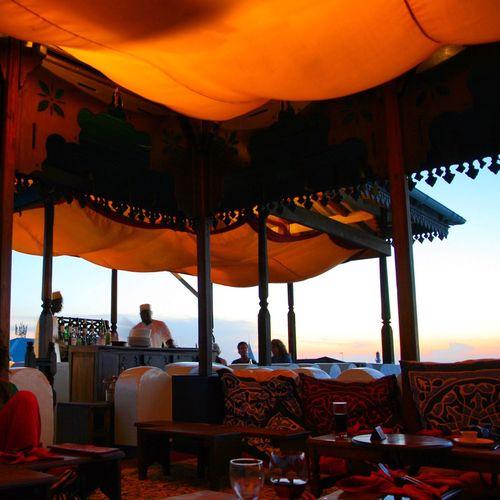 Zanzibar Zanzibar_Tanzania Stonetown Roof Rooftop Sky Sunset Sitting People Architecture Lantern Illuminated Ambient Atmosphere Sundown Lightandshadow Light Sky And City Tanzania Restaurant Rooftop View  Rooftopview Rooftop Bar EyeEmNewHere Neighborhood Map The Photojournalist - 2017 EyeEm Awards