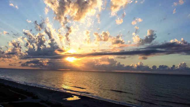 Atmosphere Awe Beach Beauty In Nature Cloud Cloud - Sky Dramatic Sky Horizon Over Water Idyllic Majestic Moody Sky Nature Scenics Sea Seascape Shore Sky Sun Sunset Tourism Tranquil Scene Tranquility Travel Destinations Vacations Water