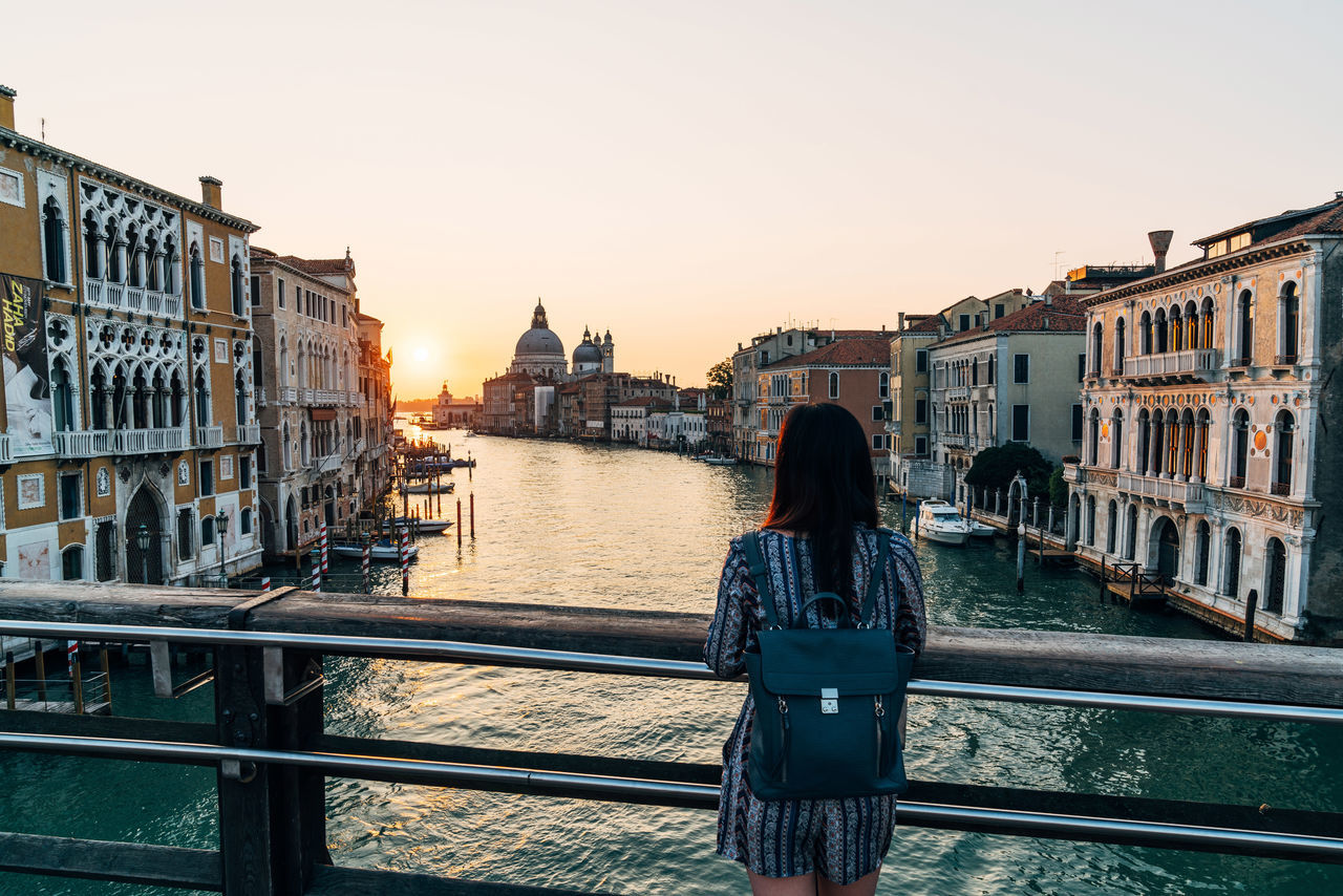 Adult Adults Only Architecture Bridge - Man Made Structure Building Exterior Built Structure City City Break Cityscape Cultures Nautical Vessel One Person One Woman Only Only Women People Real People Rear View Sunset Tourism Tourist Travel Destinations Venice, Italy Women Young Adult Young Women