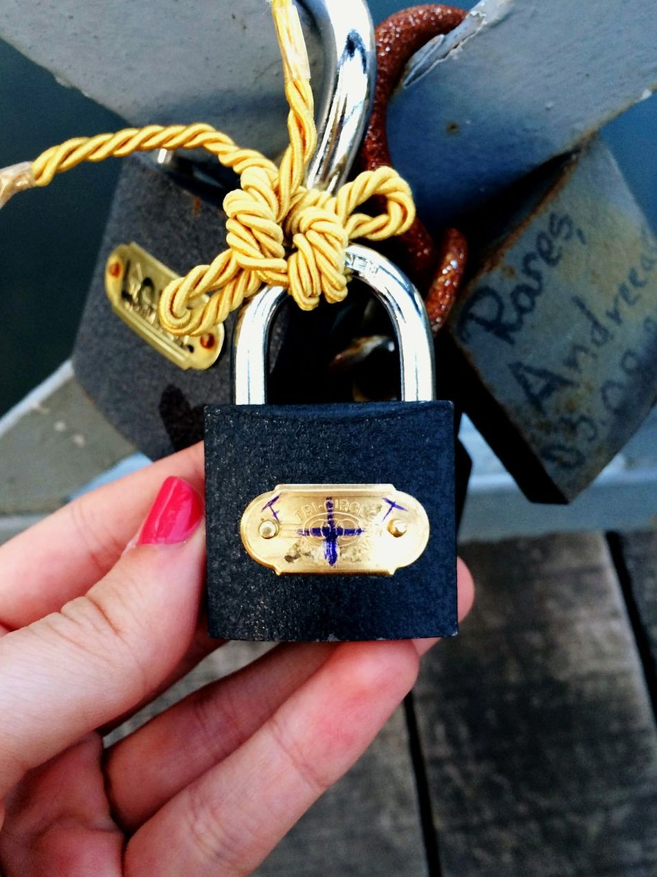 Close-up Holding Gold Colored Rust Lock Mylocks Love Locks Of Love Mylove From My Point Of View Art Is Everywhere Old Bow Monogram Art Photography Fine Art Photography Todayphotography Eye4photography  Couples Lovepictures City Life Lovebridge Bridge Eyeemphotography