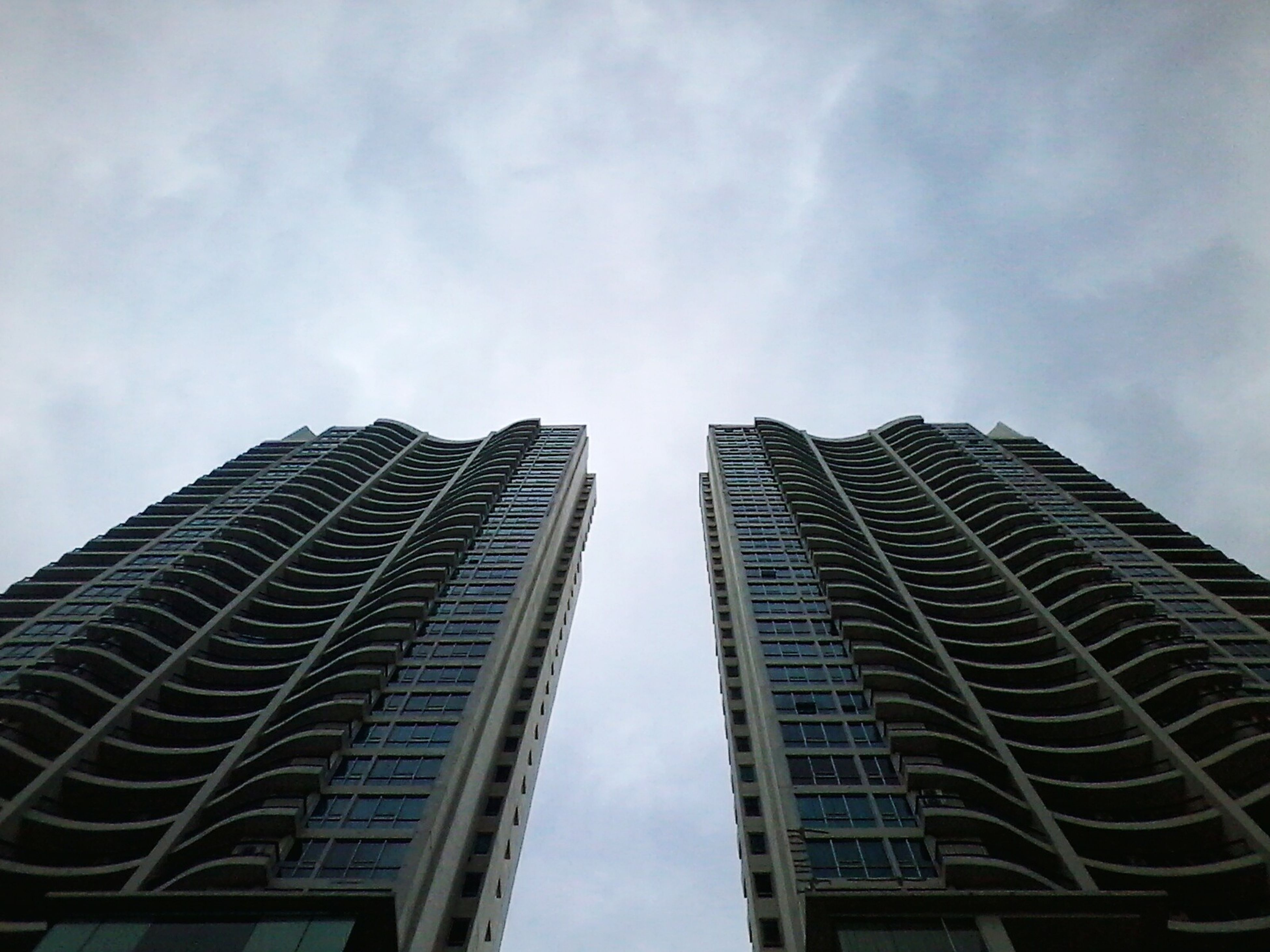 architecture, building exterior, low angle view, built structure, modern, skyscraper, tall - high, office building, sky, city, tower, glass - material, cloud - sky, building, tall, day, cloud, outdoors, reflection, no people