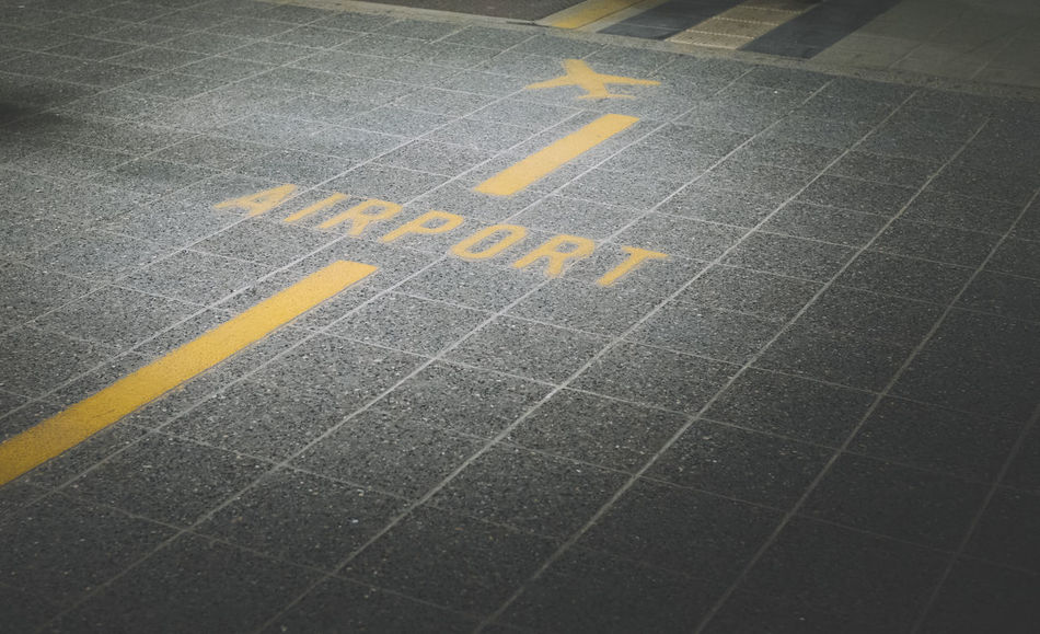 Airport Asphalt Direction Directional Sign No People On The Way Road Sign Text Transportation Travel Yellow