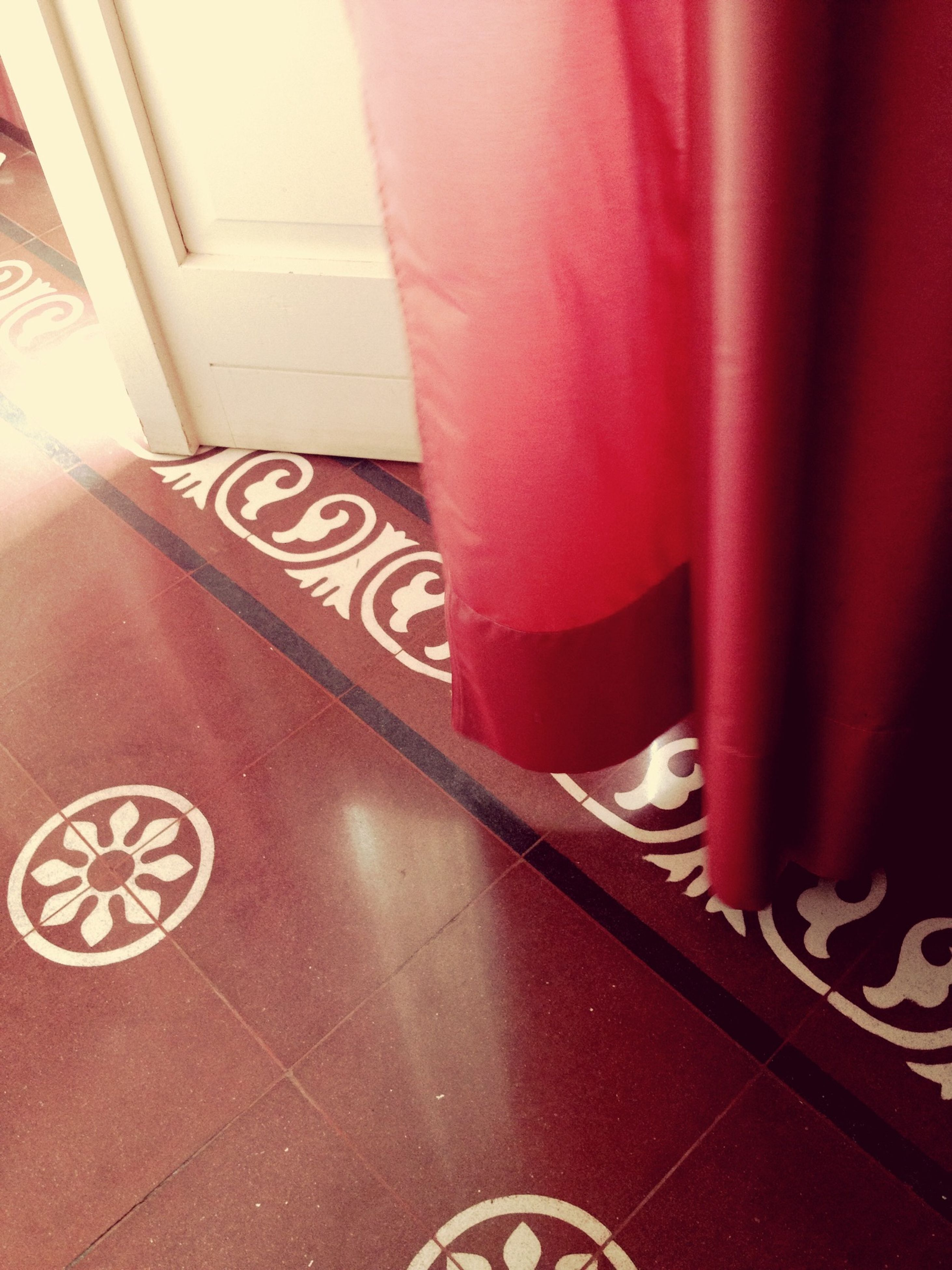indoors, text, communication, red, western script, low section, person, part of, non-western script, tiled floor, lifestyles, number, close-up, men, unrecognizable person, wall - building feature