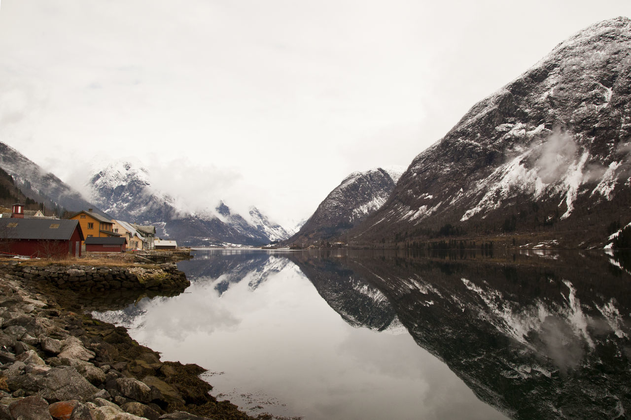 Fjærland / Visit to the book town Clouds Clouds And Sky Day Fjord Fjordsofnorway It's Cold Outside Landscape Landscape_Collection Mountain Mountain Range Mountain_collection Mountains Norway Outdoors Reflection Reflections Showcase: January Snow Water Reflections Wooden House