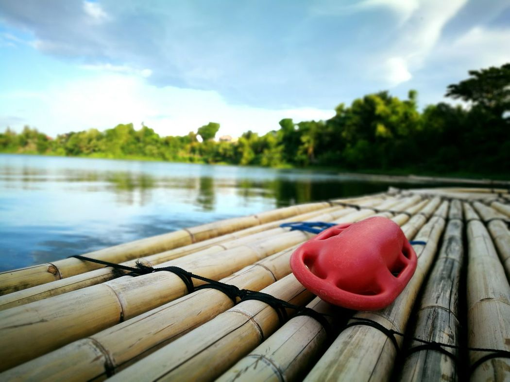 grab and float... 🏞🏊 ........... Taking Photos Focus On Foreground Mobile Photography Selective Focus Eyeem Philippines HuaweiP9plus Huawei P9 Plus Huawei Wide Aperture Open Edit Lake Lake View Relaxing Buoy Red Orange Kokopaps